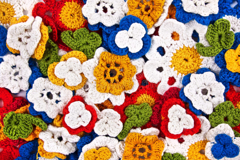 Multicolor crocheted flowers background royalty free stock image
