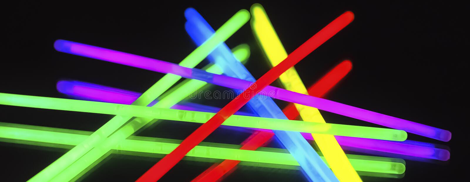 Multicolor fluorescent chem light neon black background. Variation of multicolored colorful colored fluorescent chem light neon tube with reflection on mirror stock images