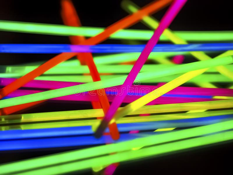 Multicolor fluorescent chem light neon black background. Variation of multicolored colorful colored fluorescent chem light neon tube with reflection on mirror stock photos