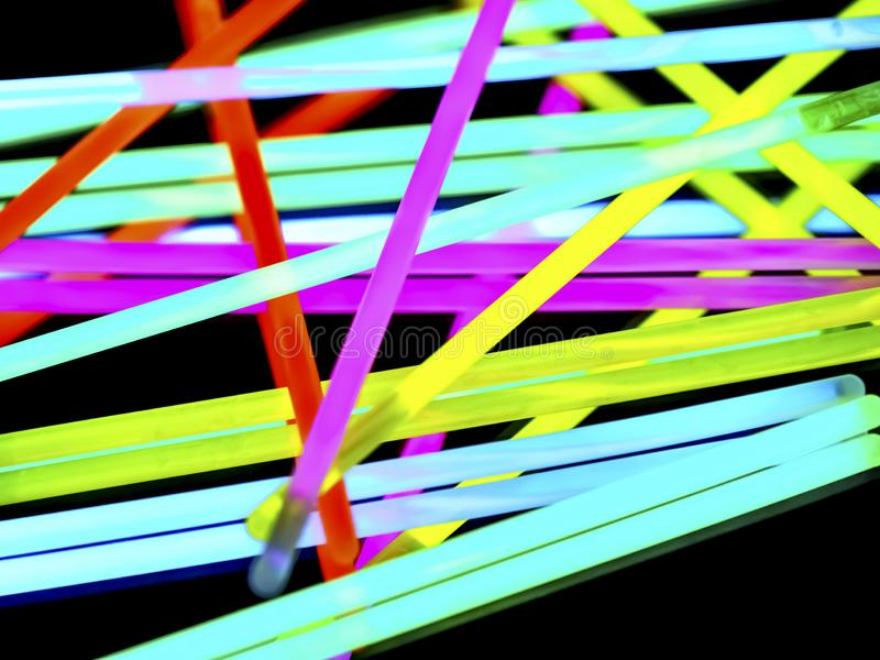 Multicolor fluorescent chem light neon black background. Variation of multicolored colorful colored fluorescent chem light neon tube with reflection on mirror royalty free stock photography