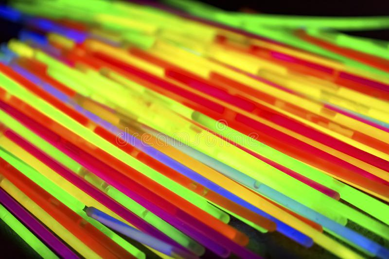 Multicolor fluorescent chem light neon black background. Variation of multicolored colorful colored fluorescent chem light neon tube with reflection on mirror stock photography