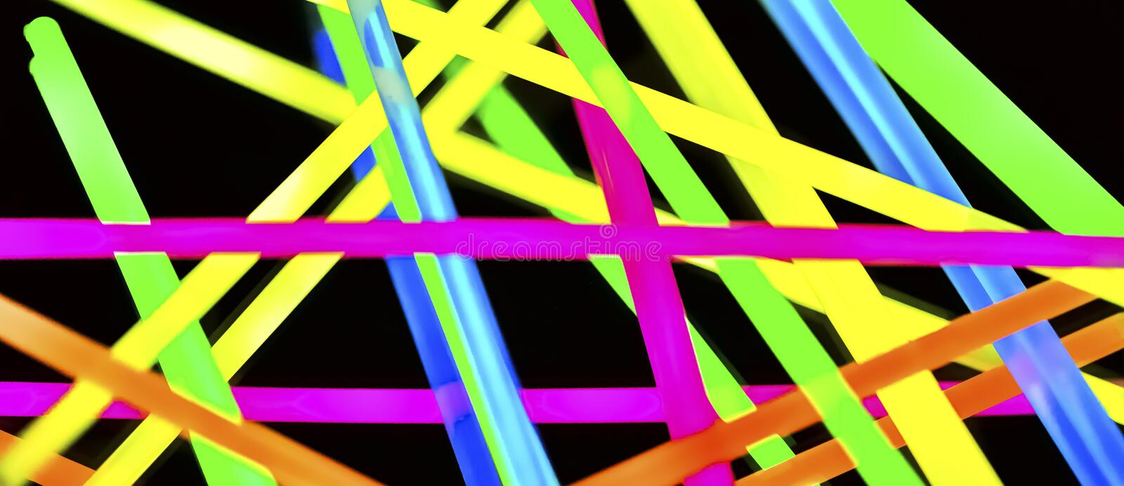 Multicolor fluorescent chem light neon black background. Variation of multicolored colorful colored fluorescent chem light neon tube with reflection on mirror royalty free stock image