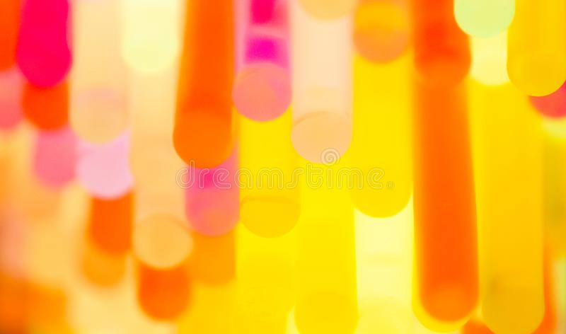 Multicolor fluorescent chem light neon black background. Variation of multicolored colorful colored fluorescent chem light neon tube with reflection on mirror royalty free stock photos