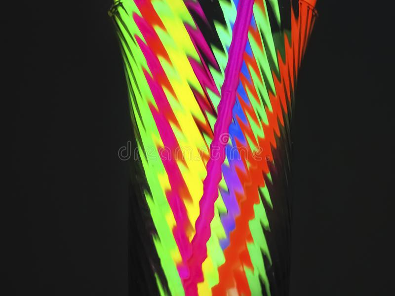 Multicolor fluorescent chem light neon black background. Variation of multicolored colorful colored fluorescent chem light neon tube with reflection on mirror stock photo
