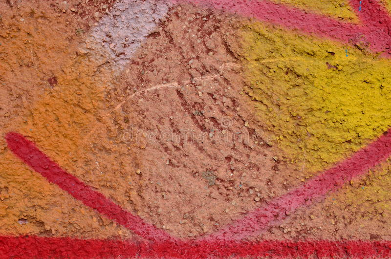 Multicolor graffiti paint. Stucco coated wall airbrushed with orange, pink and yellow paint stock photography