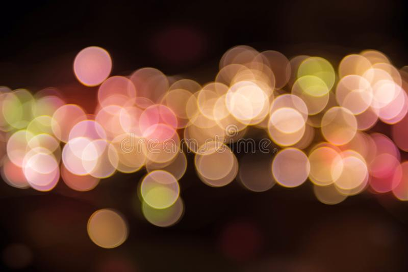 Multicolor lights bokeh on a black background royalty free stock photography