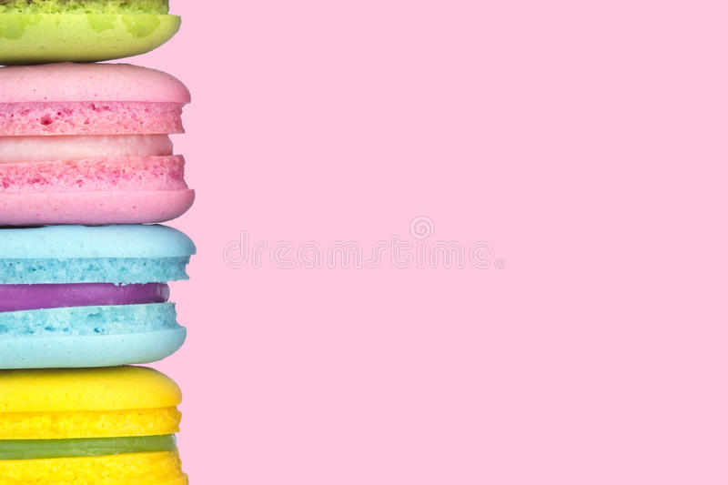 Multicolor macaron on pastel pink color background,copy space royalty free stock photos