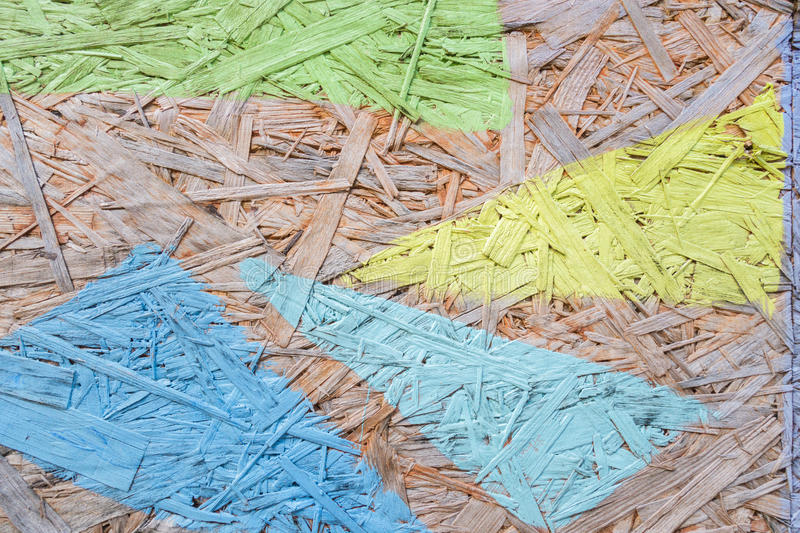 Multicolor painted wood chipboard texture background. Green, yellow, blue painted wood chipboard texture background. Close up stock images