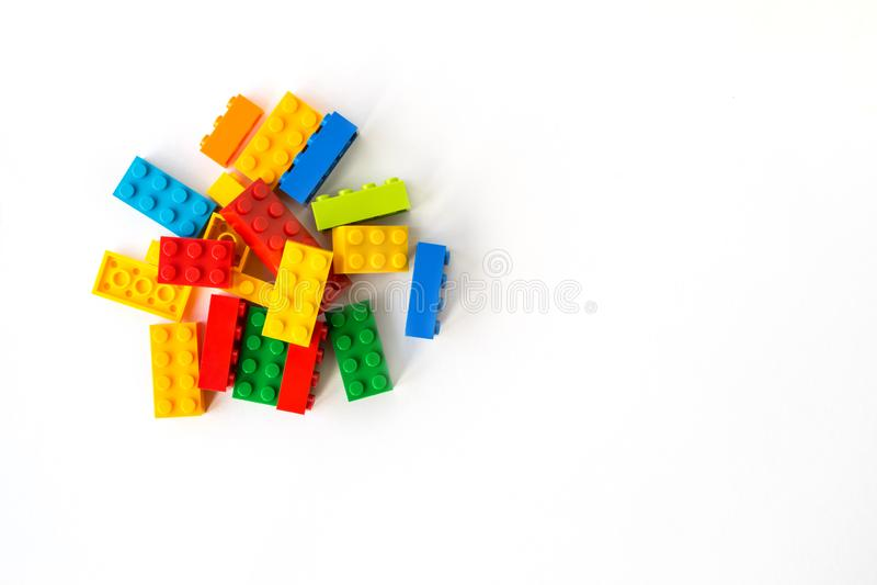 Lego backround. Multicolor Plastick constructor bricks on white background. Popular toys. Copyspace. Lego backround. A bunch of Multicolor Plastick constructor stock photography