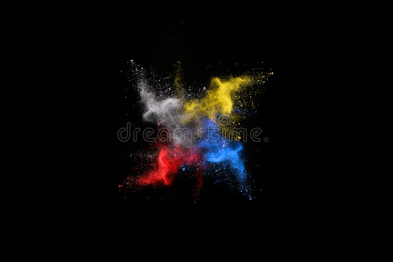 Multicolor powder explosion on black background. stock photography