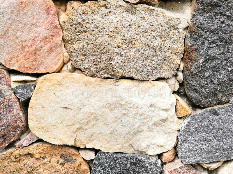 Stone wall beautiful color texture background house royalty free stock photography
