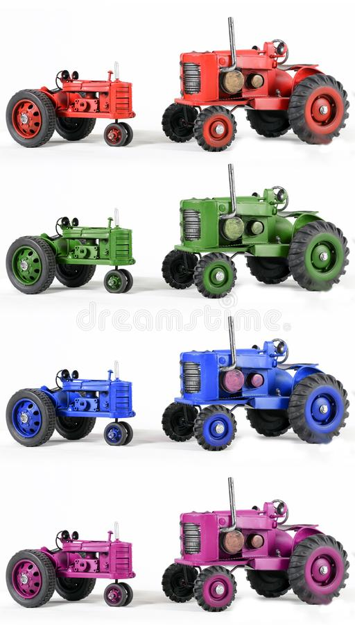 Multicolor Toy Tractors. Two Toy Tractors in multi colors stock photo
