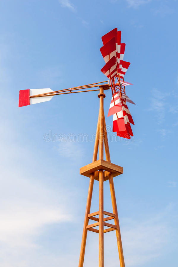 The multicolor wind vane againsts clear blue sky. The multicolor wind vane againsts beautiful clear blue sky stock photo