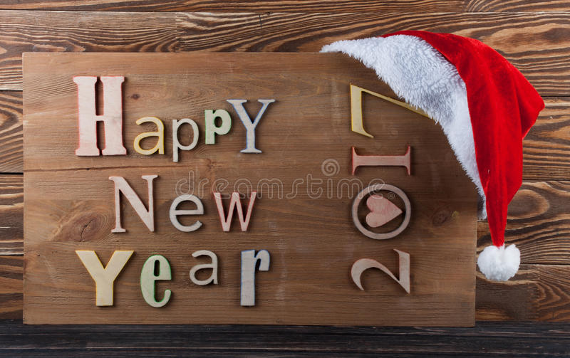 Multicolor wood inscription. Happy New Year close up. Greeting card royalty free stock photo