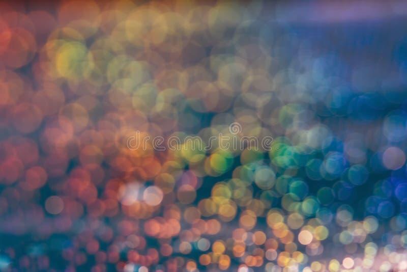 Multicolored abstracte bokehachtergrond Feestelijke mooie vage achtergrond, blauw, geel aquamarijn, groen, rood, stock foto