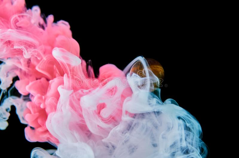 Multicolored acrylic ink in water. Abstract background royalty free stock image