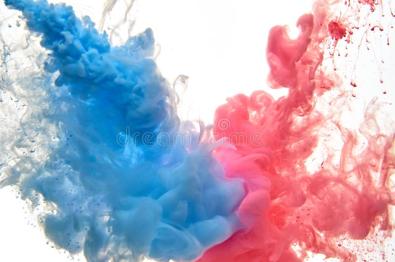 Multicolored acrylic ink in water. Abstract background royalty free stock photos
