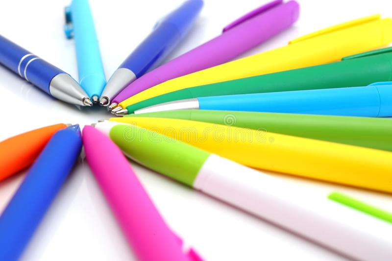 Multi colored ball pens on white background. Multicolored ball point pens isolated on white background royalty free stock photo