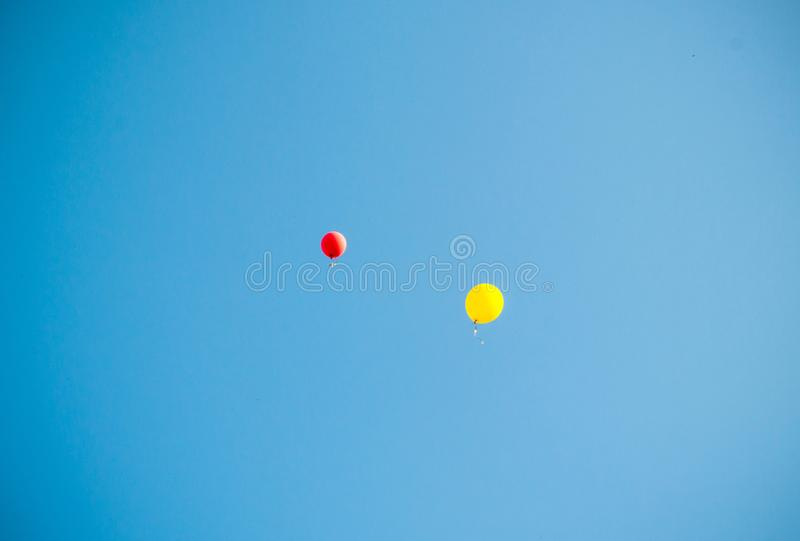 Multicolored balloons in the sky stock images