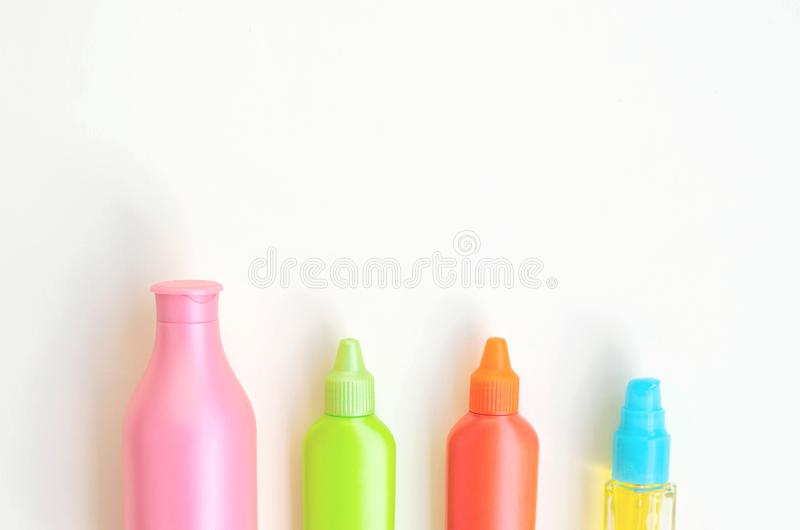 Multicolored beautiful containers for beauty care products for the whole body. Beauty, health and fashion stock images