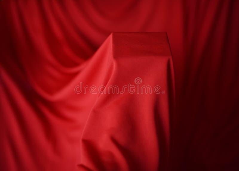 Multicolored bellenhb rode stoffenachtergrond stock afbeelding