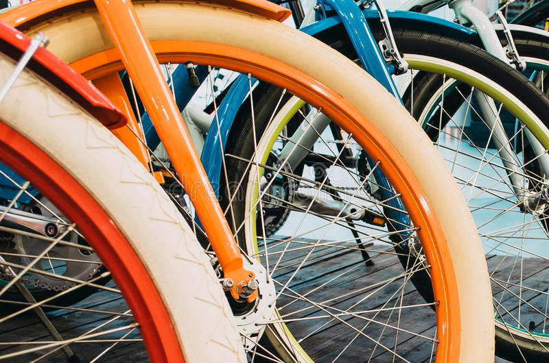 Multicolored bicycle wheels in a row, close-up. stock photos