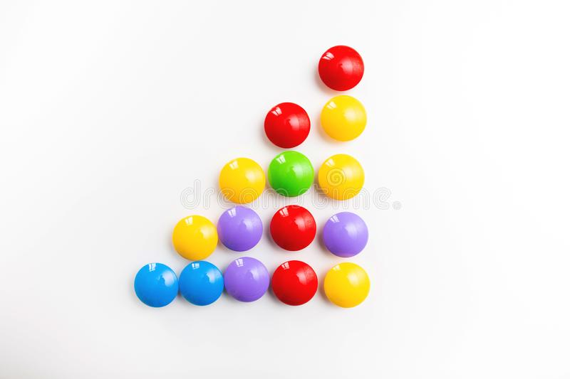 A multicolored bright background made of children`s toys.  stock image