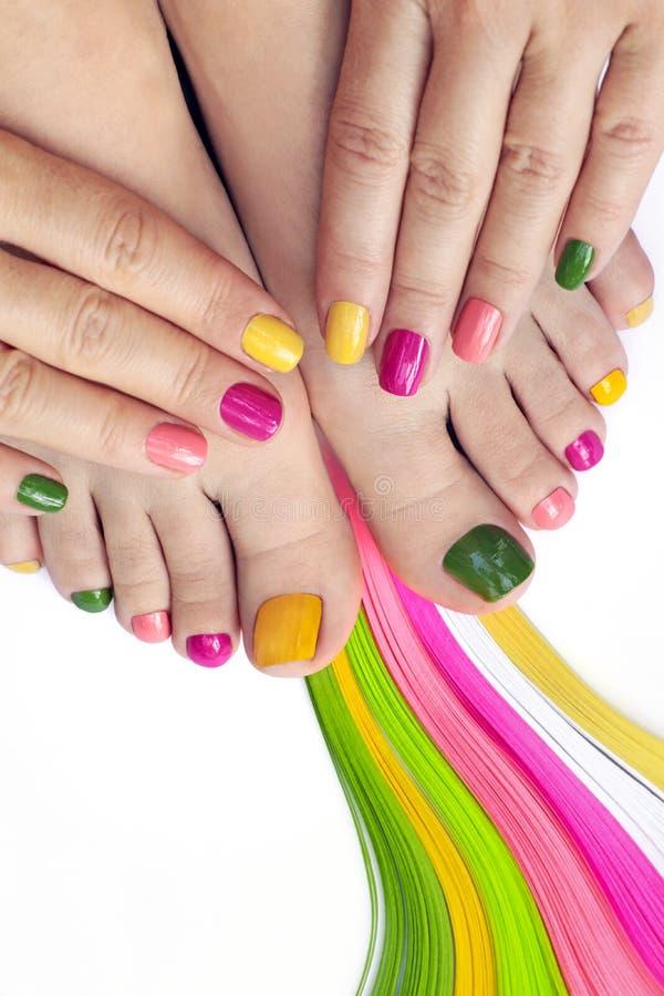 Multicolored bright manicure and pedicure stock photos