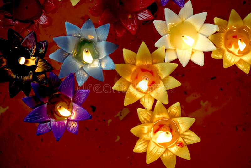 Multicolored Candle lighting, floating in the tub. stock photos