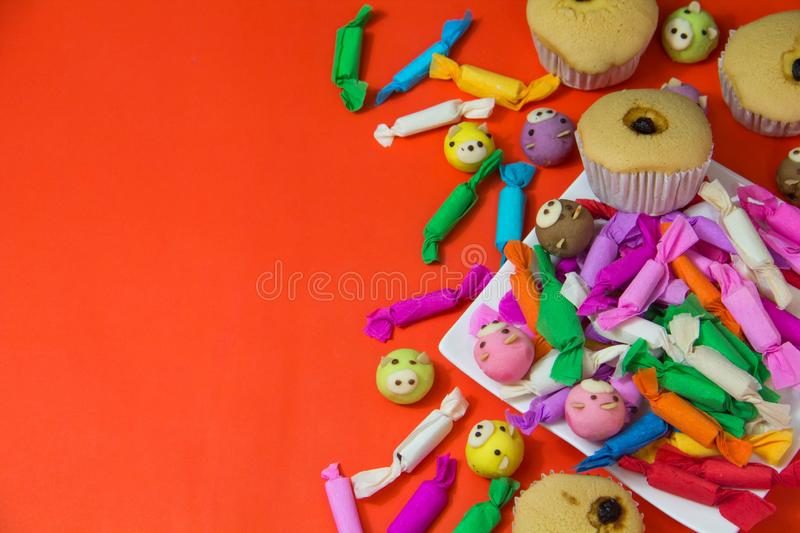 Multicolored candy and cup cake stock image