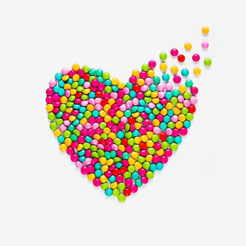 Multicolored candy dragees heart stock images