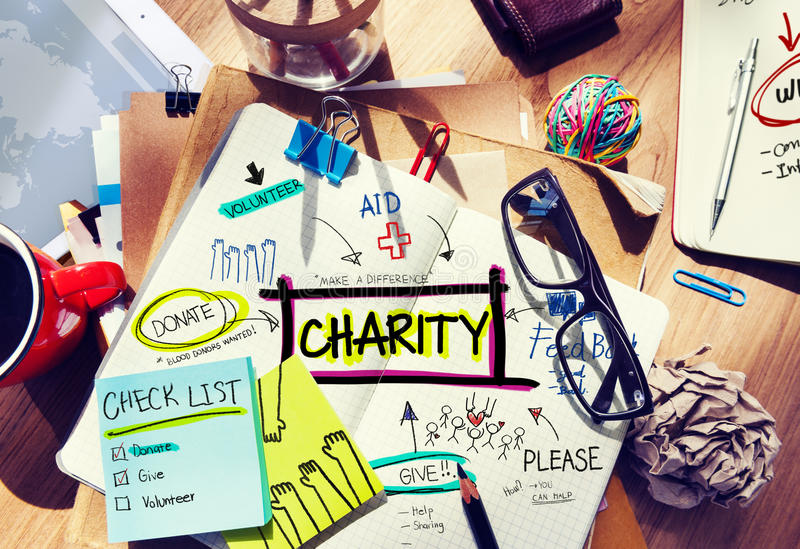 Multicolored Charity Concept Desk with Notes stock image