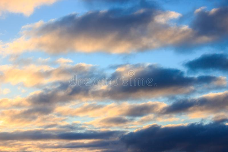 Multicolored clouds at dawn. bright sky filled with sun, the morning of a new day. active awakening of the world stock image