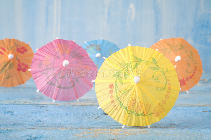 Multicolored cocktail umbrellas stock images