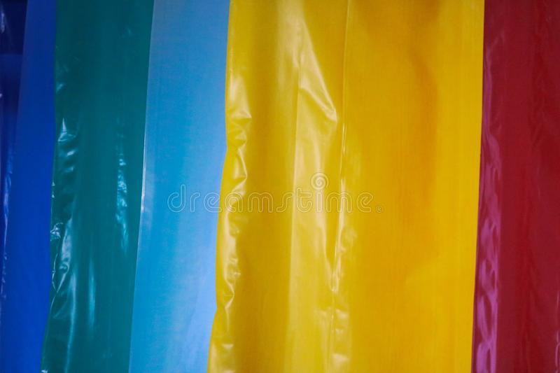 Multicolored colored bright motley rolls of plastic film. Chemical production, high-pressure polyethylene stock images