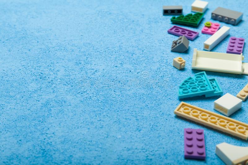 Multicolored constructor on a blue background. Empty space for text stock photo