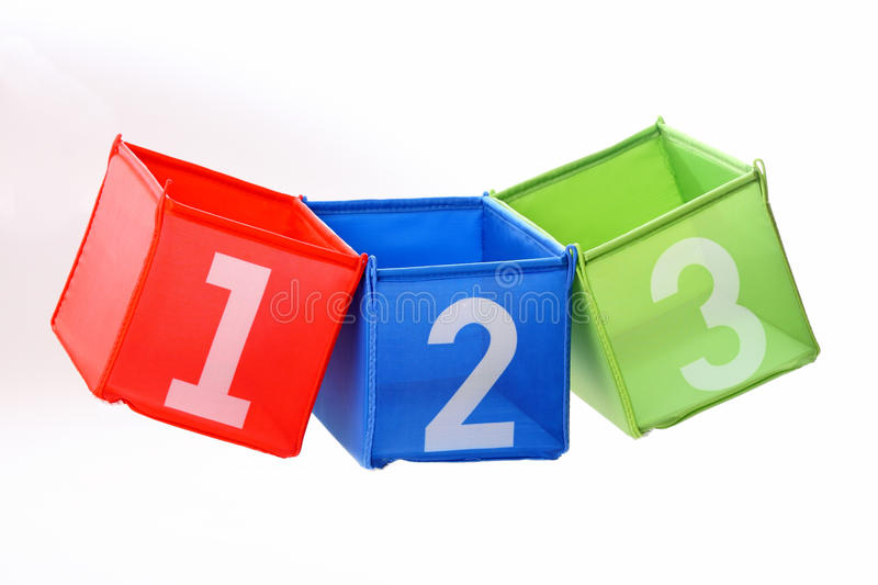 Multicolored containers isolated on white. Multicolored containers with numbers isolated on white stock photos