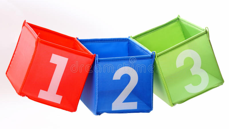 Multicolored containers on white. Multicolored containers with numbers isolated on white royalty free stock image