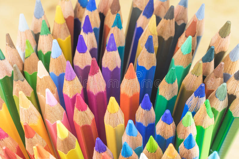 Multicolored crayons ready for use. The large number of disordered multicolored crayons. Photographed from a larger angle royalty free stock images
