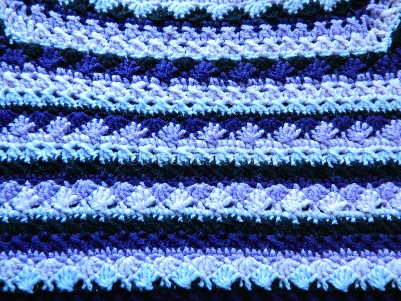 Multicolored crocheted canvas. knitting stock image