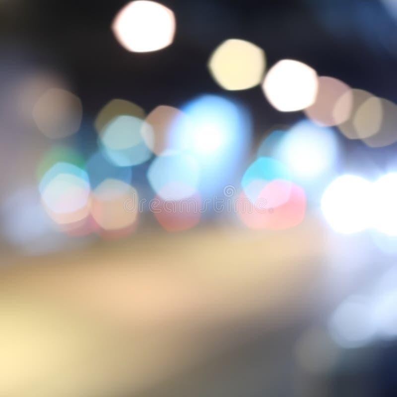 Multicolored defocused bokeh lichten van nachtstraat royalty-vrije stock foto