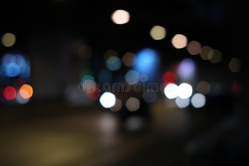 Multicolored defocused bokeh lichten van nachtstraat royalty-vrije stock afbeelding