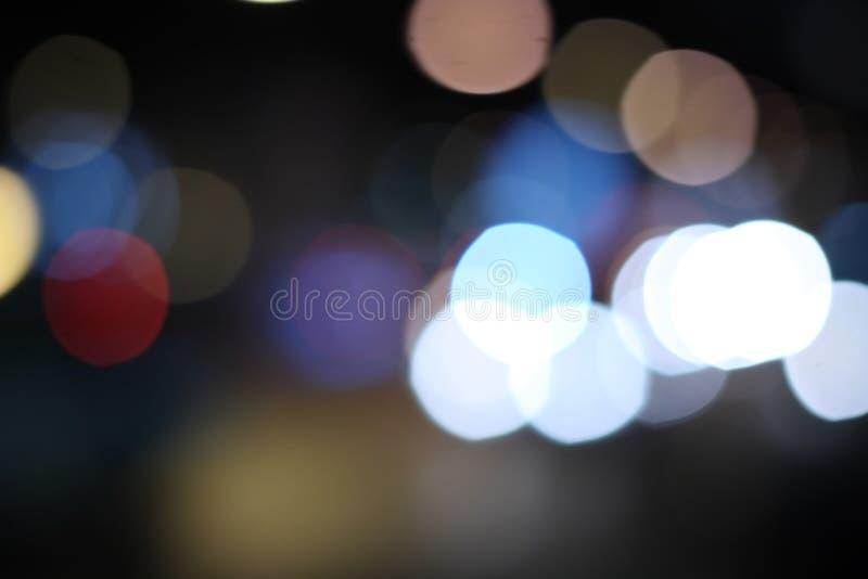 Multicolored defocused bokeh lichtenachtergrond stock afbeelding