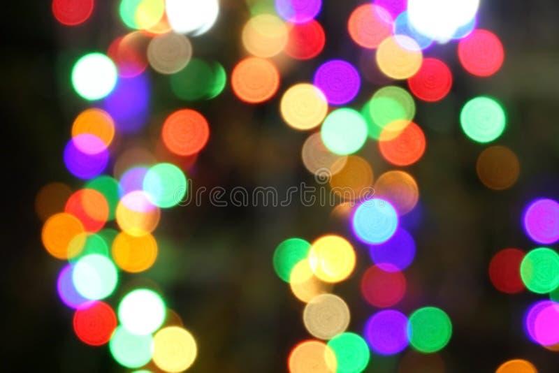 Multicolored defocused bokeh lichtenachtergrond stock fotografie