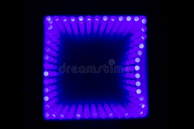 Multicolored defocused bokeh lights background. Illuminated table royalty free stock photography