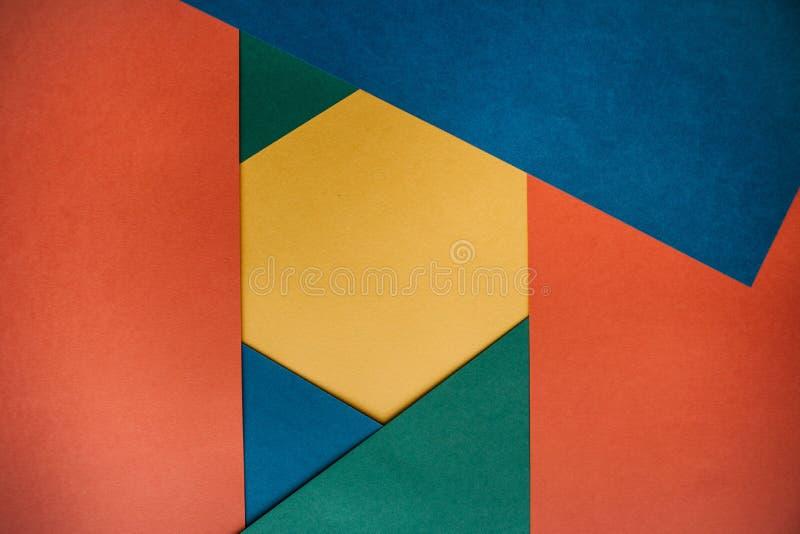 Multicolored document die een geometrische vorm met ruimte voor tekst vormen royalty-vrije stock afbeeldingen