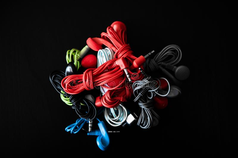Multicolored earphones ready for use stock photography