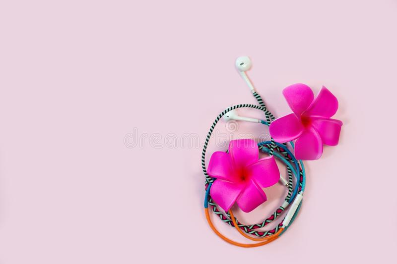Multicolored earphones top view summer music concept stock photography