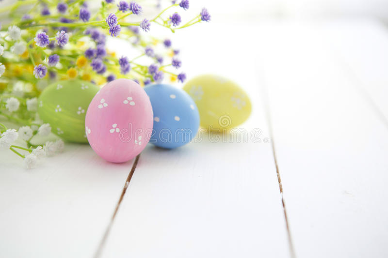 Multicolored Easter eggs in fresh flowers daisy. royalty free stock photo