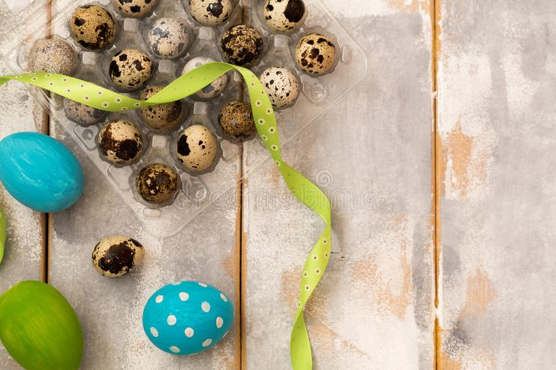 Download Multicolored Easter Eggs In Plastic Box And Ribbons On A Wooden Background Country Style